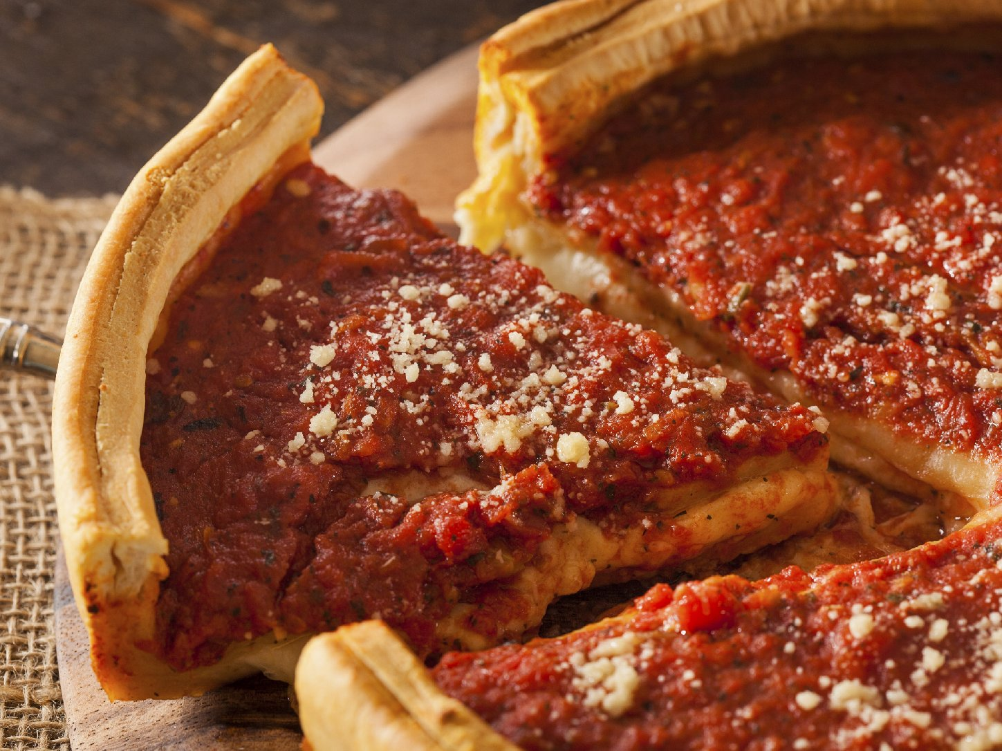"Comedy Central's Jon Stewart has called Chicago-style pizza ""tomato soup in a bread bowl."" Photo: iStockphoto"
