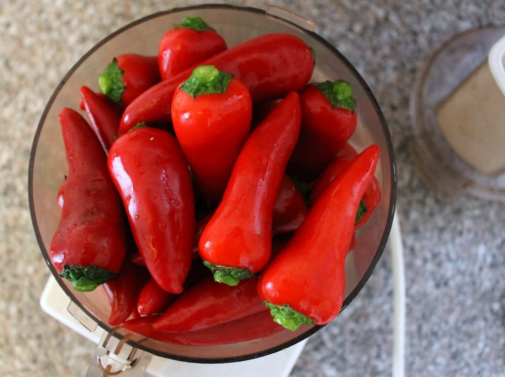 Use easy-to-find red Fresno chiles for a medium-hot sauce, or add spicier chiles, like habaneros, for a more daring blend. Whichever you choose, pulse them to a mash in a food processor. Photo: Kate Williams