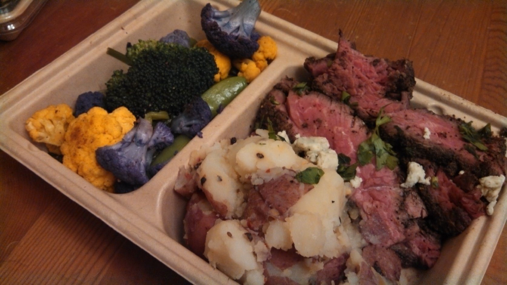 The steak and potatoes didn't look like much in its tray. Photo: Kelly O'Mara