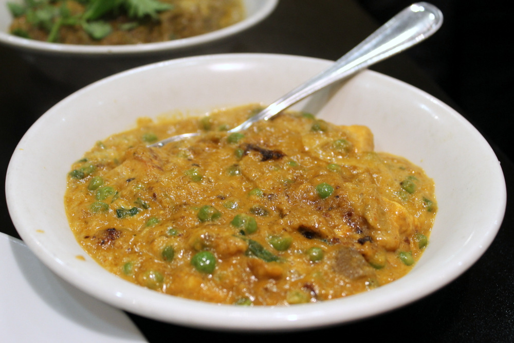 Matar paneer is a vegetable curry featuring peas and cubes of paneer cheese. Photo: Kate Williams