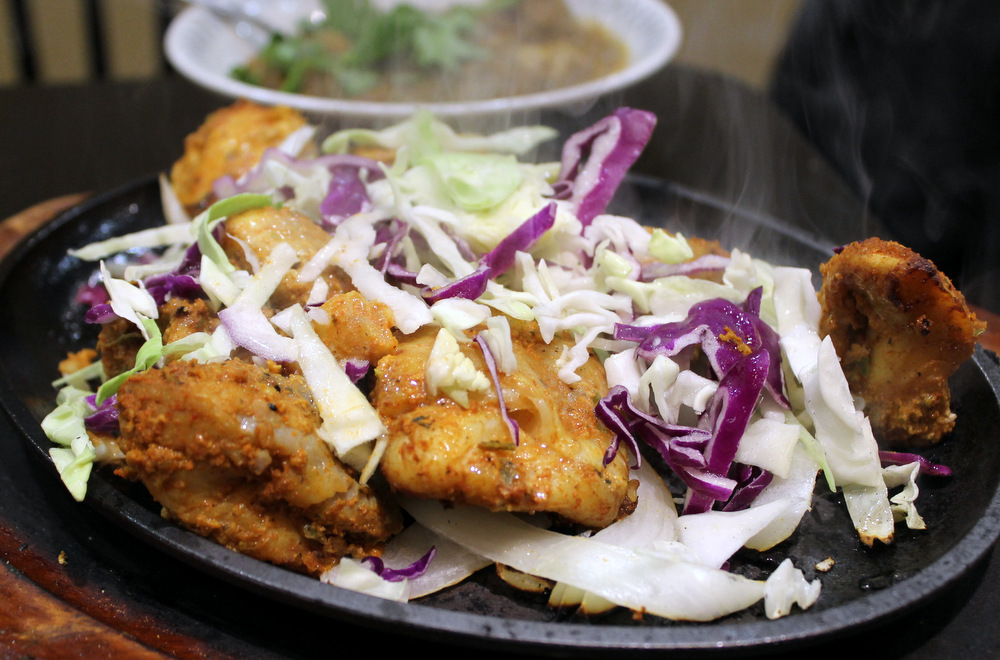 Guddu de Karahi's tandoori fish draws legions of fans to the Sunset. Photo: Kate Williams