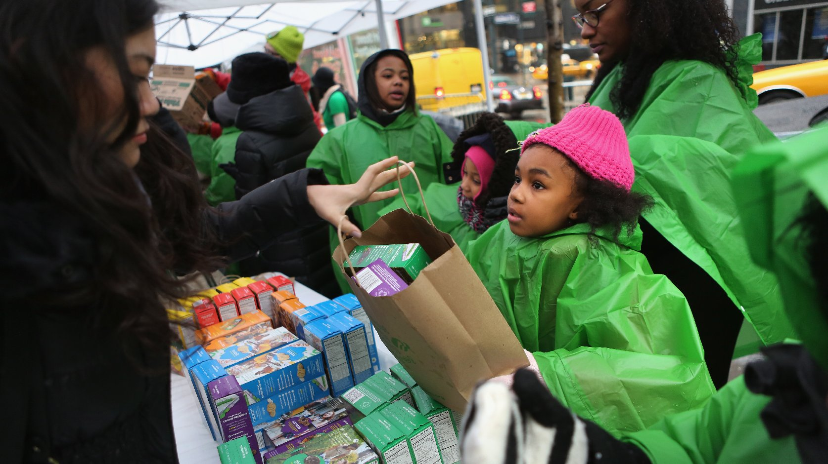 Girl Scouts sell cookies as a winter storm moves in on February 8, 2013 in New York City. Photo: John Moore/Getty Images