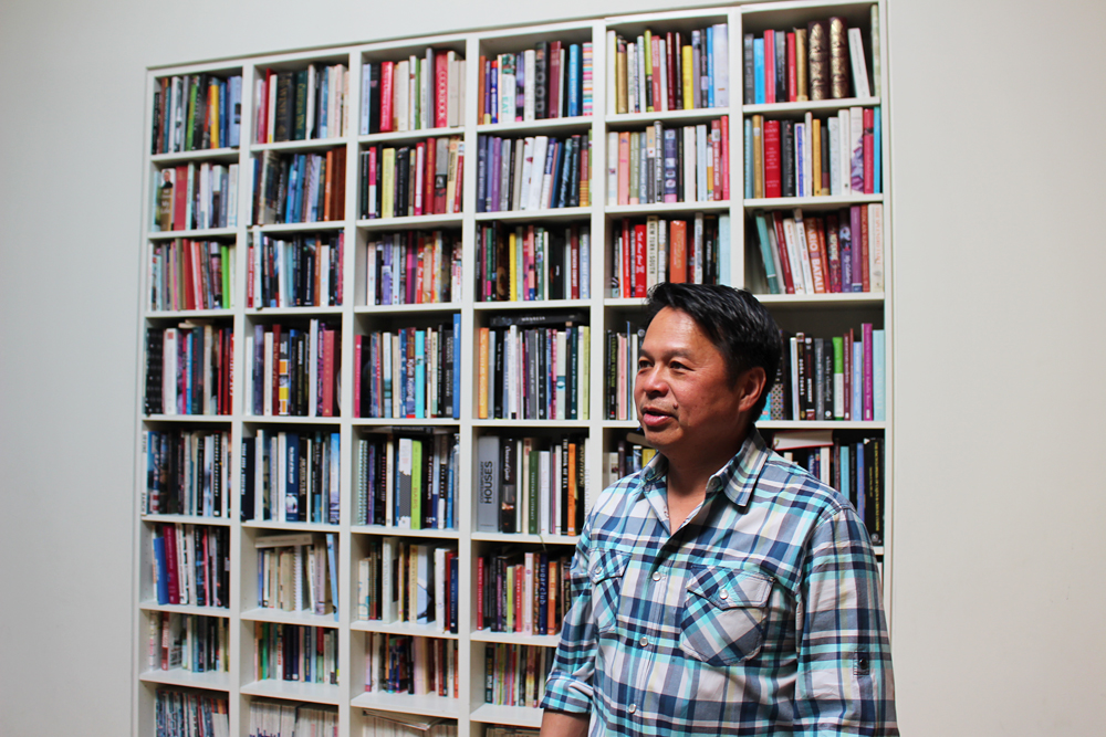 Charles Phan at home in front of his bookcase. Photo: Wendy Goodfriend