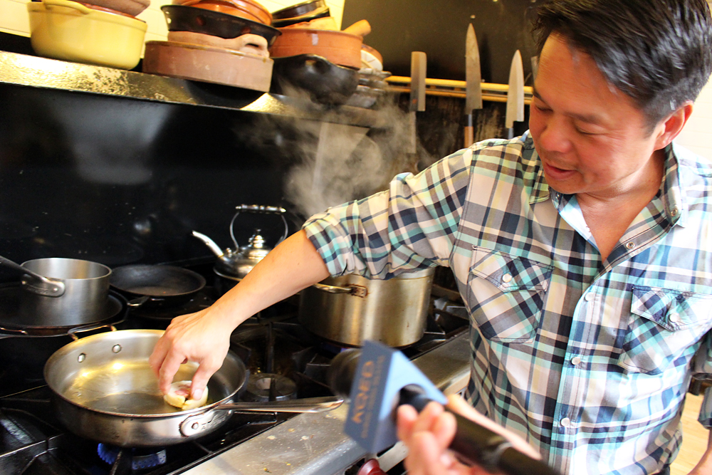 Charles Phan cooking sliced banh chưng. Photo: Wendy Goodfriend