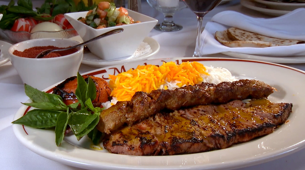 Maykadeh Solanti - Skewered thin slices of filet mignon marinated in lime juice & onion plus one skewer of Koobideh