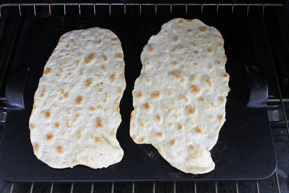 Bake the matzo directly on a pizza stone until golden brown on both sides. Photo: Kate Williams