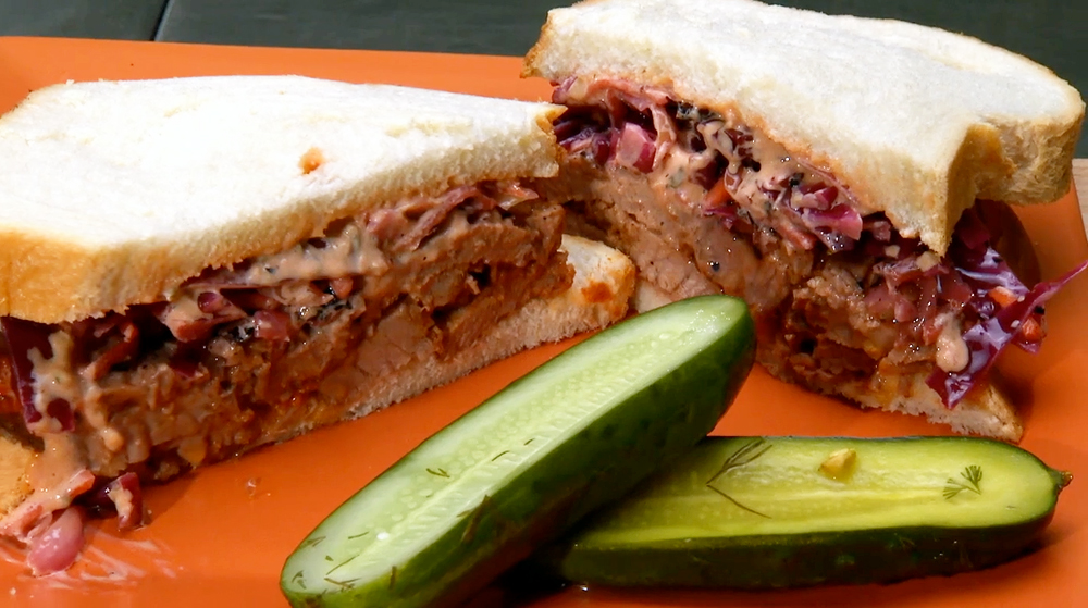 Paulie's Pickling Braised Brisket Sandwich - grilled coleslaw, Russian dressing, sliced sourdough bread