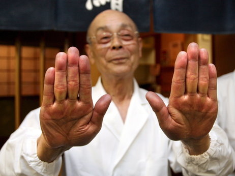 Master sushi chef Jiro Ono shows off his famously soft hands, one of the secrets to his renowned sushi, in front of Ono's sushi restaurant, Sukiyabashi Jiro, in Tokyo, Japan. Located in the drab basement of an old Tokyo office building, Sukiyabashi Jiro is considered the best sushi shop in the world by major food critics. Photo: Everett Kennedy Brown/epa/Corbis