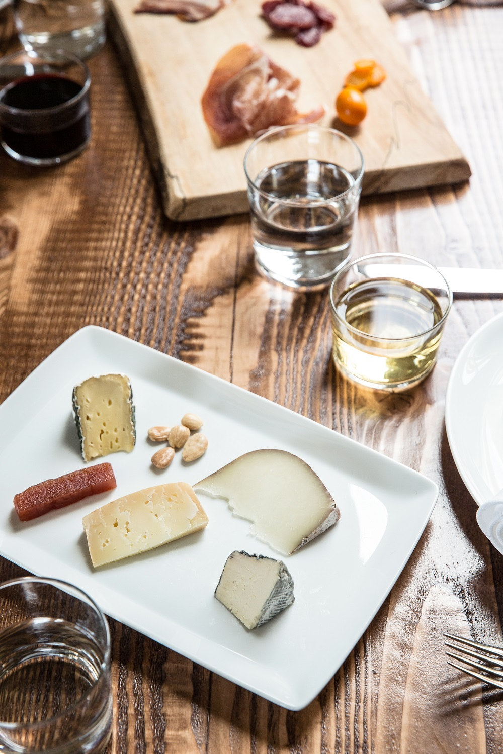 Cheese with quince paste and Marcona almonds at The Commissary. Photo: Aubrie Pick