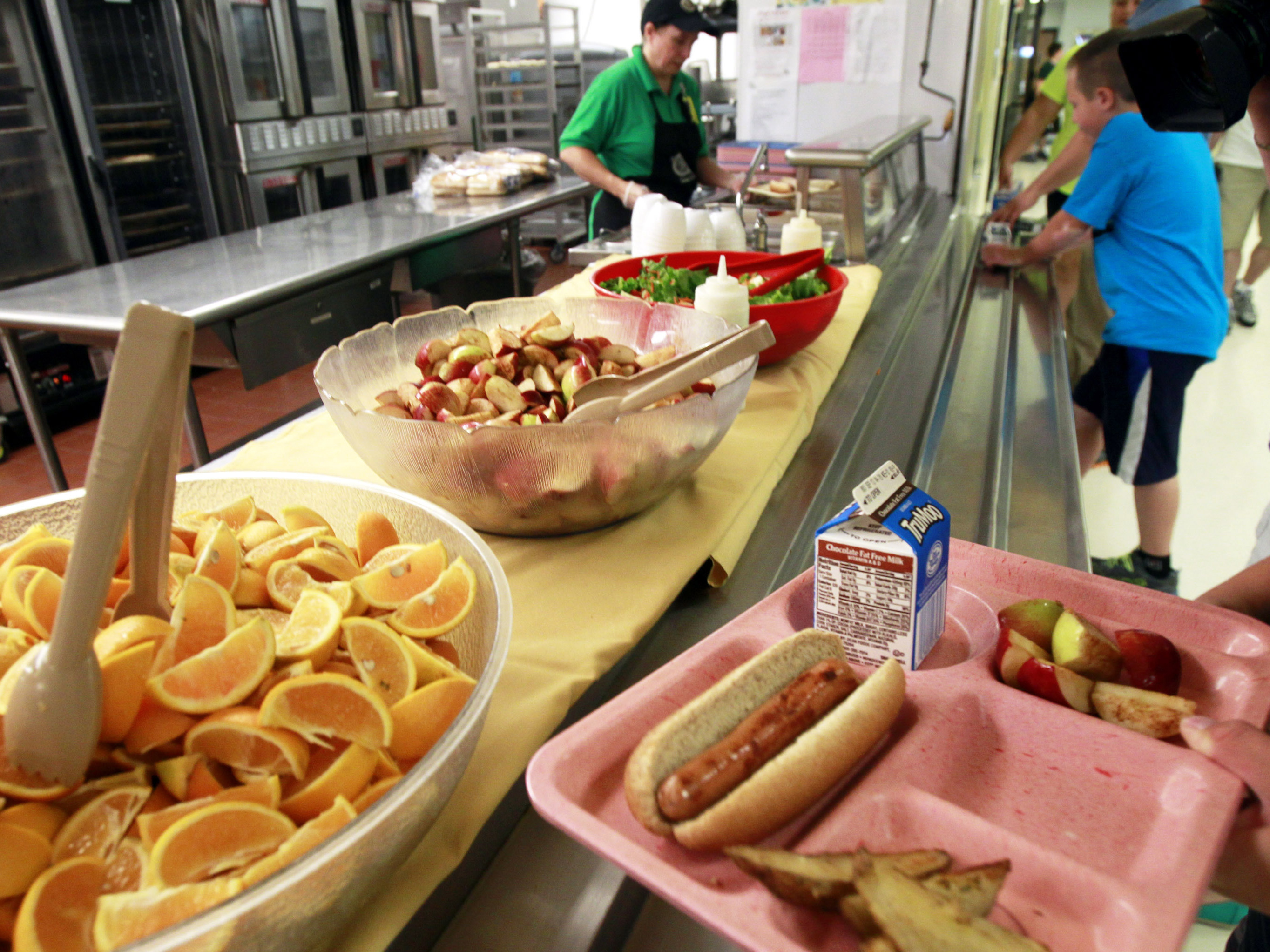 Some schools say they're having a tough time implementing new nutrition rules requiring more whole grains, more veggies and less fat. Photo: Toby Talbot/AP