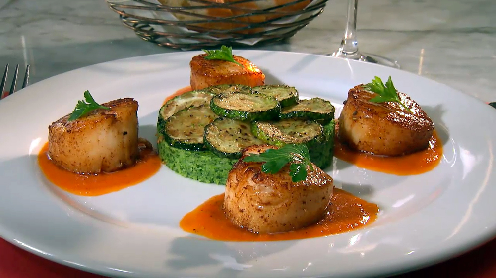 Coquilles St-Jaques au Coulis de Poivron Rouge, Puree de Brocolis and Courgettes Sautees- pan seared sea scallops with red pepper coulis, broccoli puree and sautéed zucchini at Baker Street Bistro