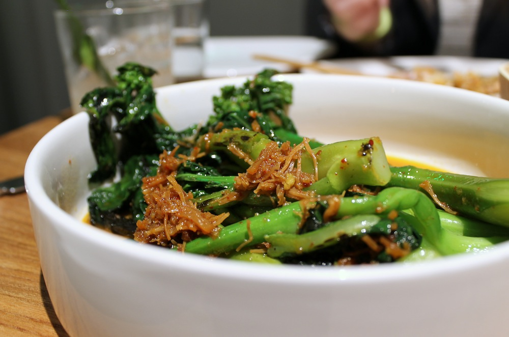 The Chinese broccoli comes sautéed and dressed with sweet and salty XO sauce. Photo: Kate Williams