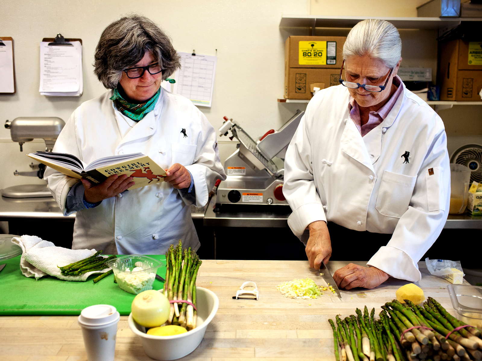 Sue Conley (left) and Peggy Smith, co-founders of Cowgirl Creamery, prepare their chilled spring garlic and asparagus soup with creme fraiche and fresh ricotta at Cowgirl Creamery in Point Reyes Station, Calif. Photo: Tim Hussin for NPR