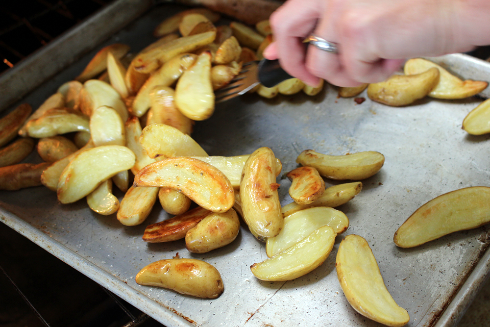 Stir potatoes roasting in oven . Photo: Wendy Goodfriend