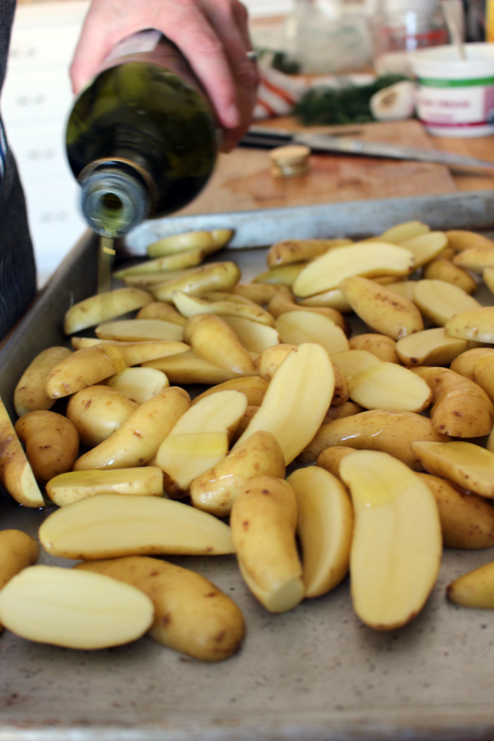 Drizzle olive oil on potatoes. Photo: Wendy Goodfriend