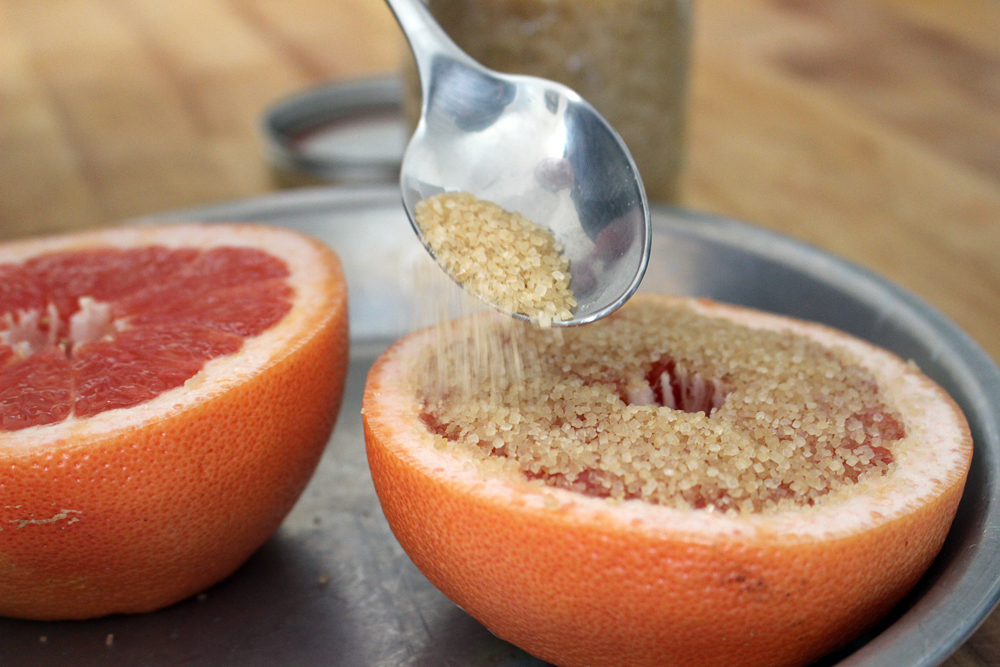 Sprinkle the cut side of each grapefruit half evenly with sugar. Photo: Wendy Goodfriend