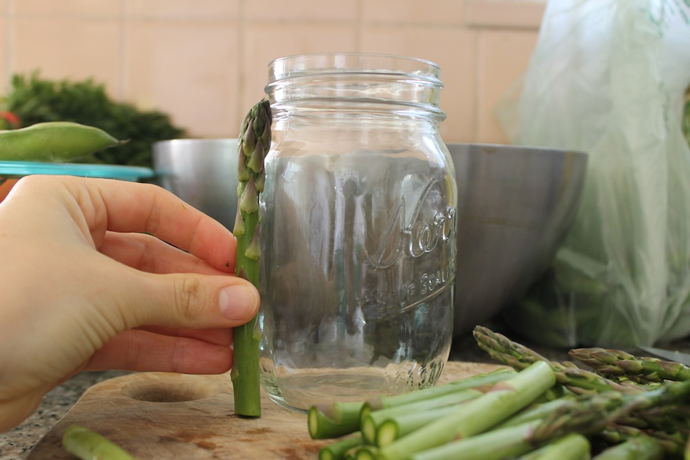 Asparagus should be trimmed of its tough base and cut into pieces that are 3 to 4 inches long. Photo: Kate Williams