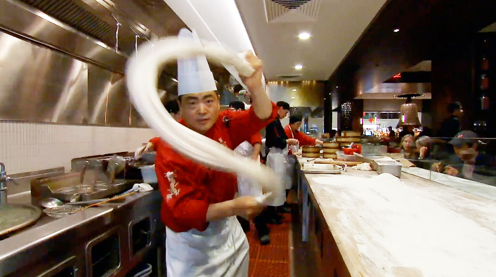 Chef Tony shows off the art of noodle pulling at M.Y. China
