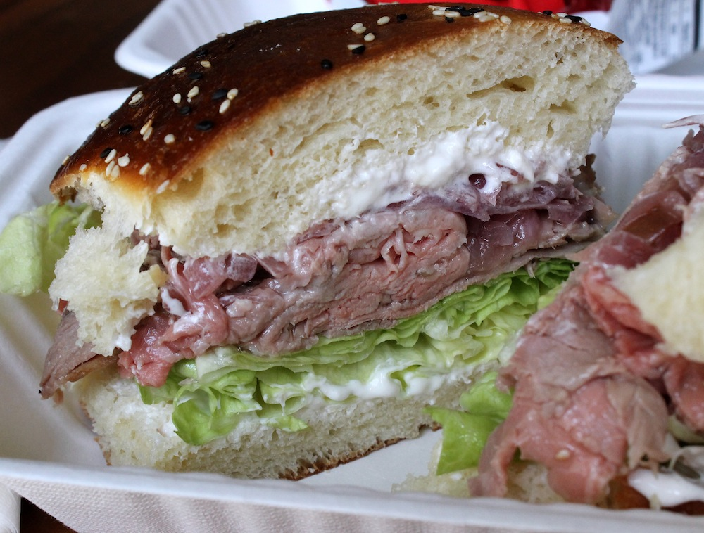 Leary's roast beef sandwich comes with house made mayonnaise, crisp lettuce, smoked pickled onions, and horseradish cream cheese. Photo: Kate Williams