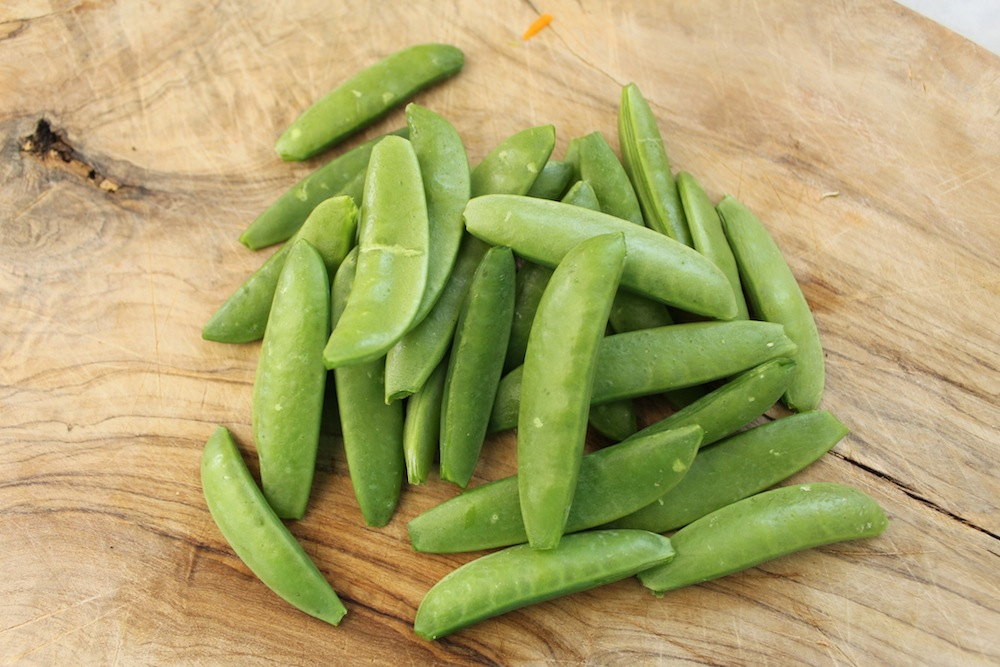 Sugar snap peas should have their tops and tails removed, as well as any tough strings. Photo: Kate Williams