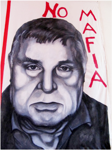 A painting of Mafia boss Salvatore Riina, on display at the Museo Anti-Mafia in Corleone, Sicily. Photo: The Kitchen Sisters