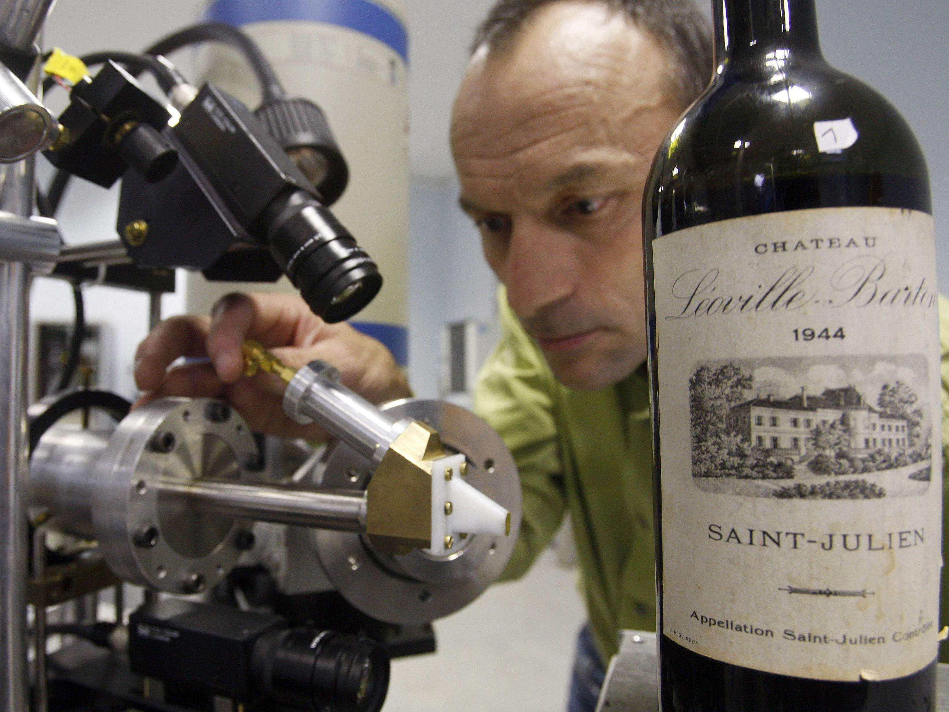 Herve Guegan of the Nuclear Research Centre of Bordeaux runs a test on a 1944 vintage bottle of Medoc wine. Photo: Regis Duvignau/Reuters /Landov
