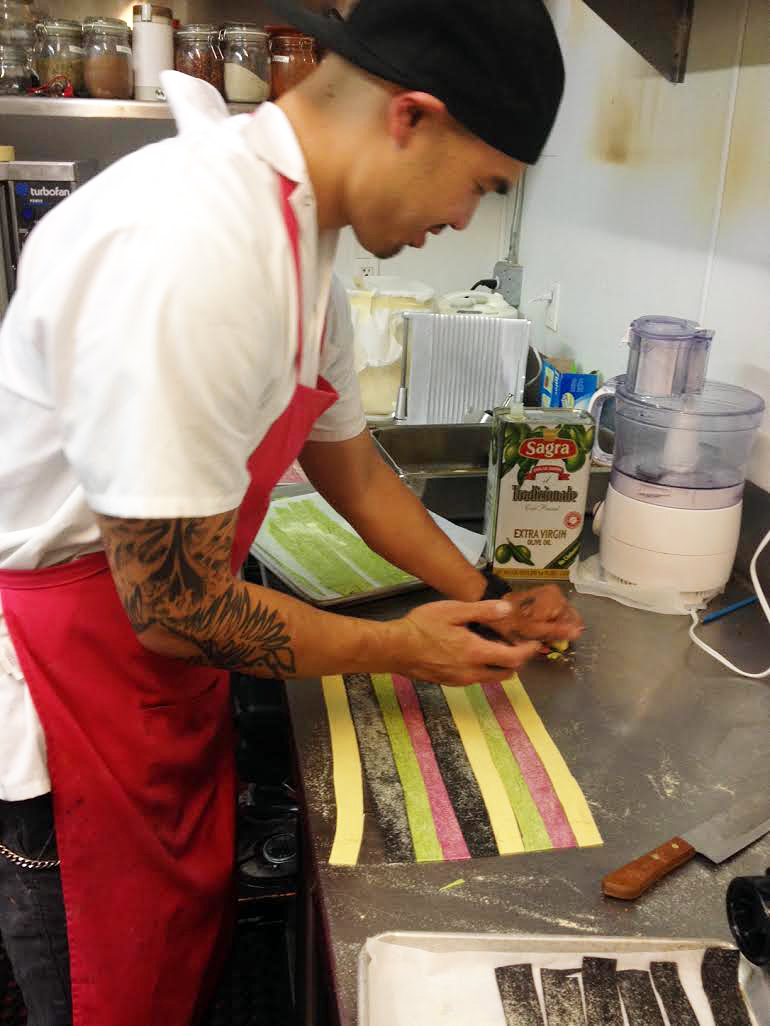 Chef Tu David Phu Making Rainbow Pasta at Dolores Park Cafe. Photo courtesy of Dolores Park Cafe
