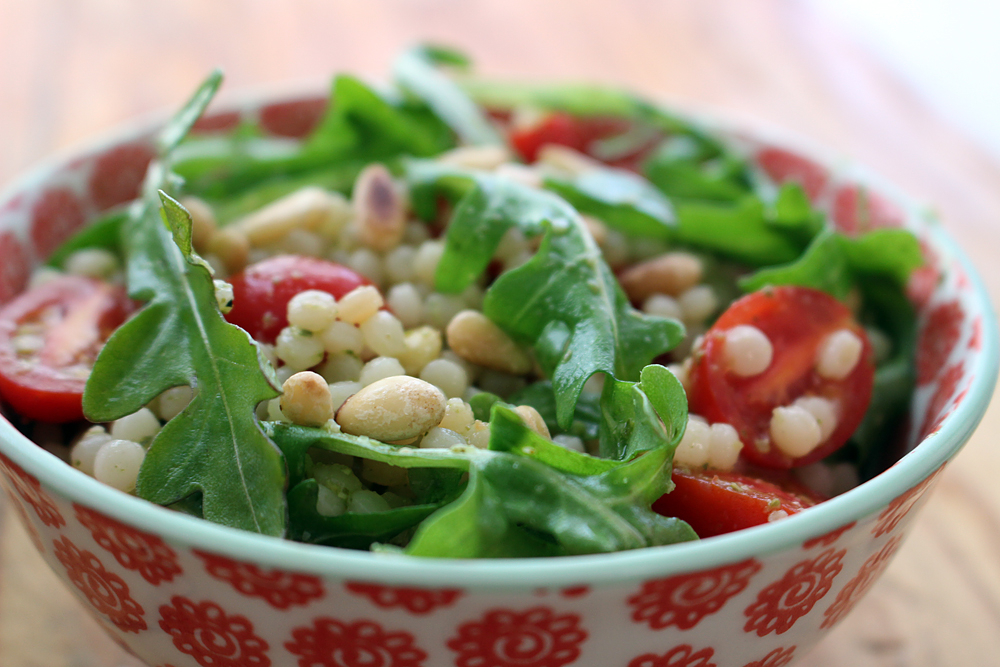 Israeli Couscous, Cherry Tomato, Arugula Salad with Basil Pesto Vinaigrette. Photo: Wendy Goodfriend
