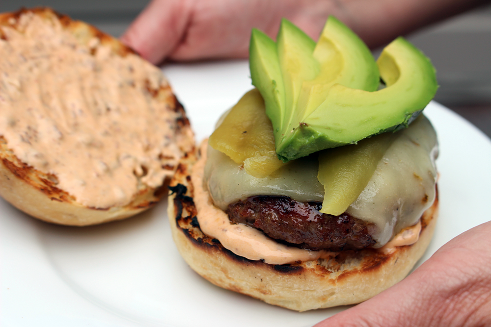 Chili burgers with Chipotle Mayo, Pepper Jack cheese, Roasted Green Chiles, and Avocado. Photo: Wendy Goodfriend