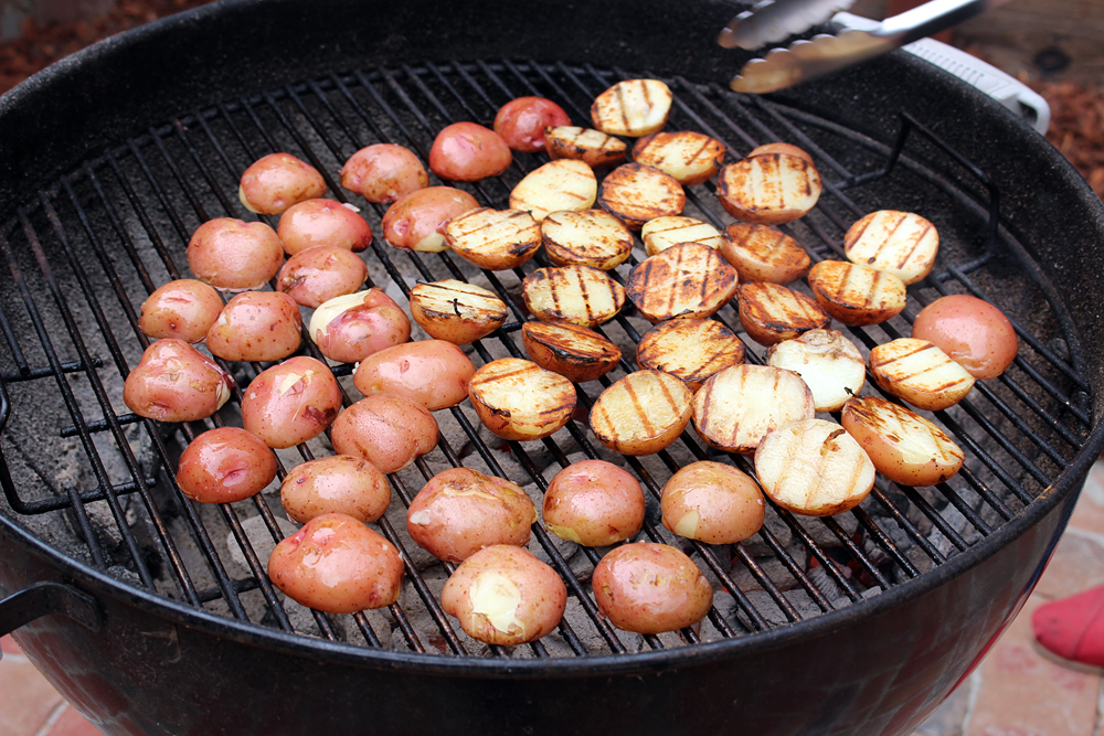 Grill potatoes on hot oiled grill
