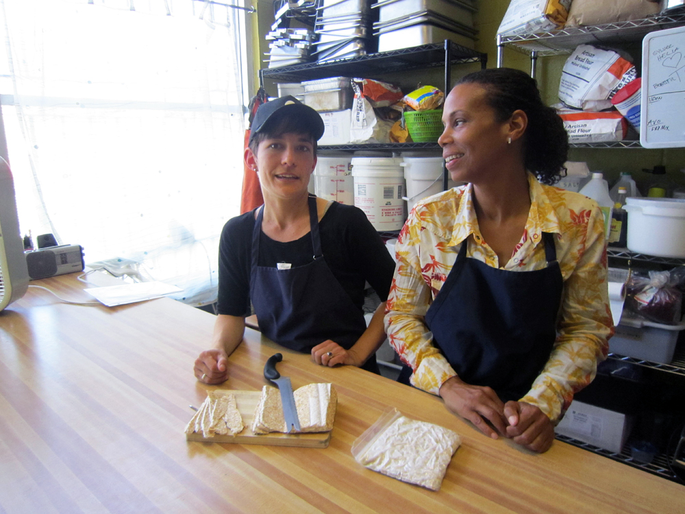 Melissa Lane, left, and Bessie Ongiri of rhizocali make tempeh in a vegan kitchen in West Oakland. Photo: Alix Wall