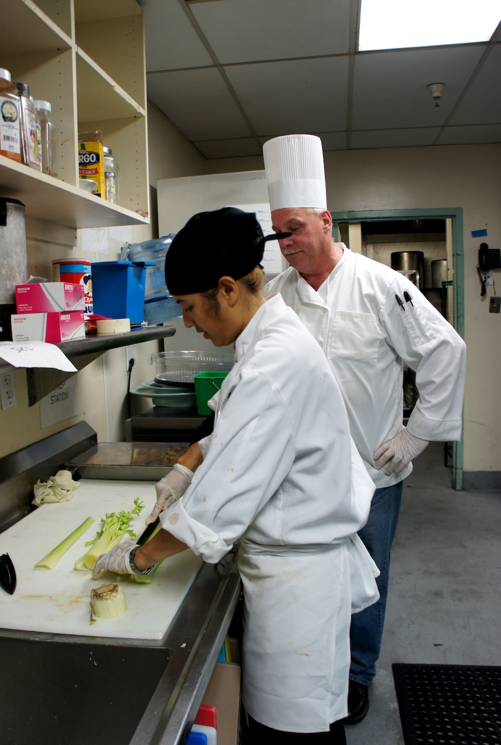 CHEFS instructor Mike Sullivan observes Safia Bubakar. Credit Angela Johnston
