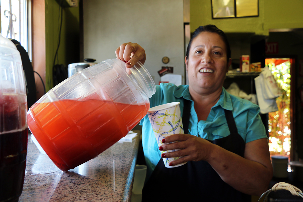Ana Maria Campos serves up strawberry agua fresca