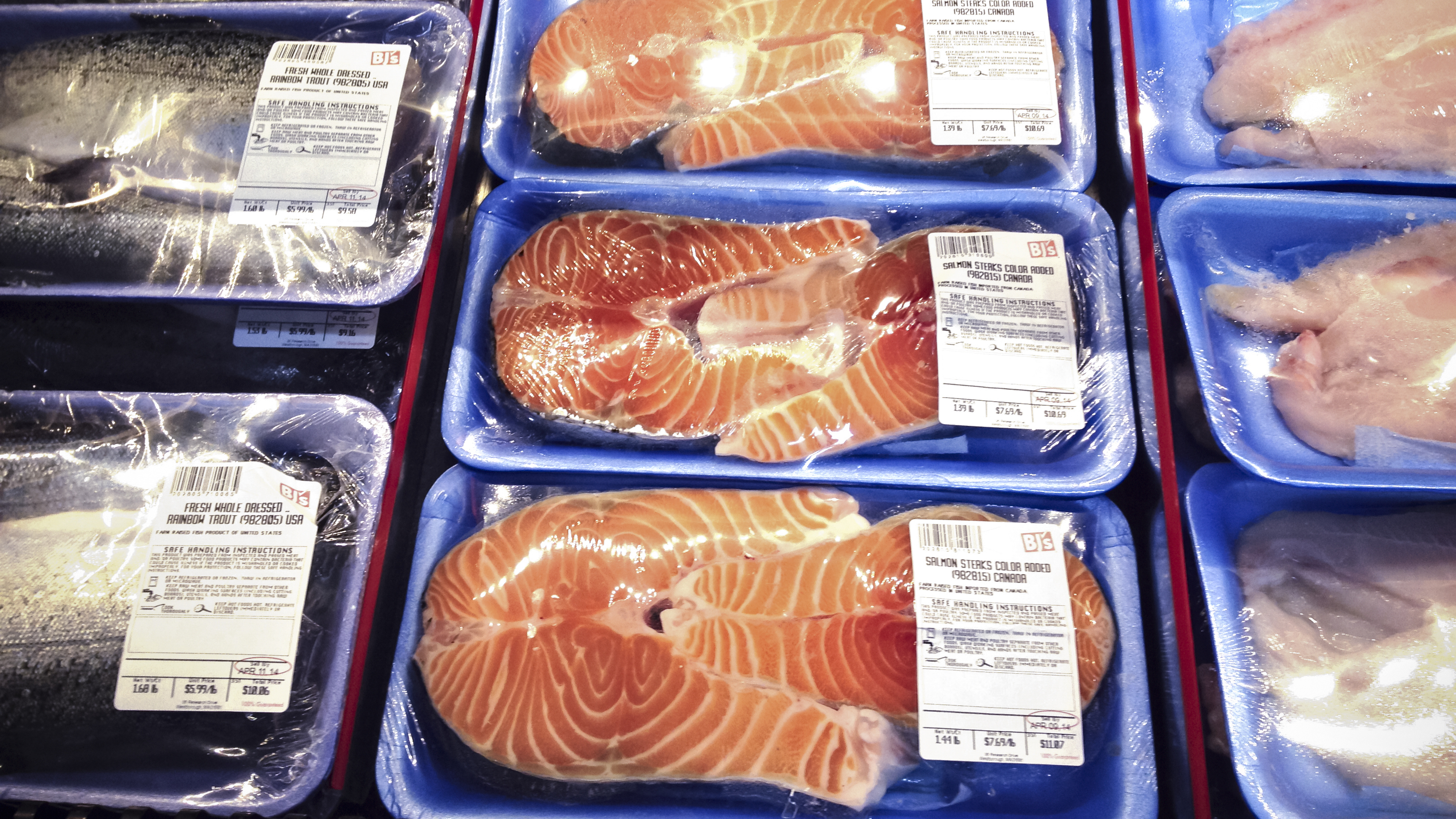 "Paul Greenberg says the decline of local fish markets, and the resulting sequestration of seafood to a corner of our supermarkets, has contributed to ""the facelessness and comodification of seafood."" Photo: J. Scott Applewhite/AP"