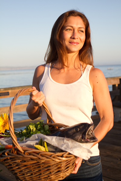 Emma Lovewell holds freshly caught black cod, a fish commonly provided to members of seafood subscription service Local Catch Monterey Bay. Photo: Alan Lovell