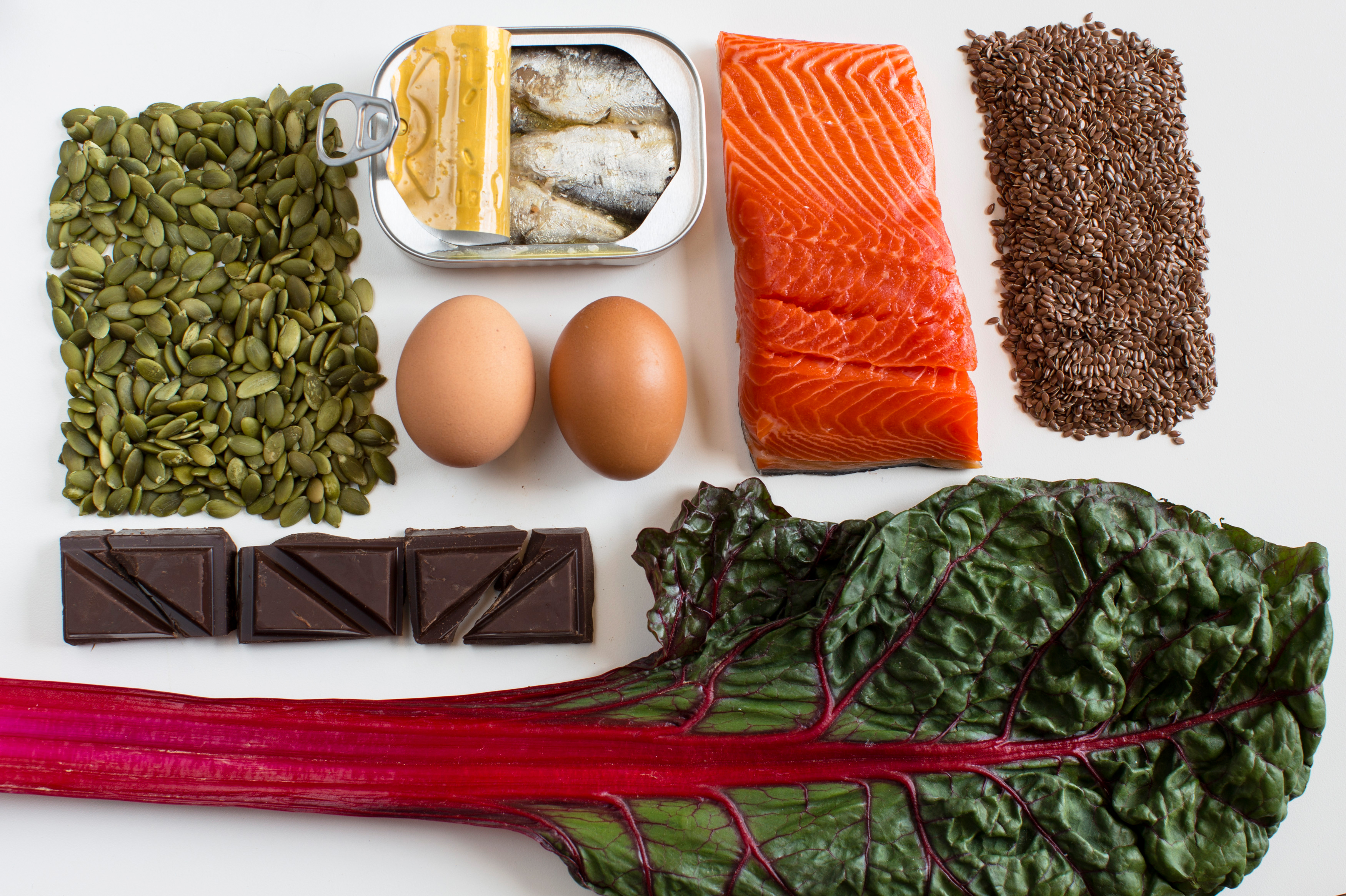 A nutrient-dense diet may help tamp down stress. And these foods may help boost our moods (clockwise from left): pumpkin seeds, sardines, eggs, salmon, flax seeds, Swiss chard and dark chocolate. Photo: Meredith Rizzo/NPR