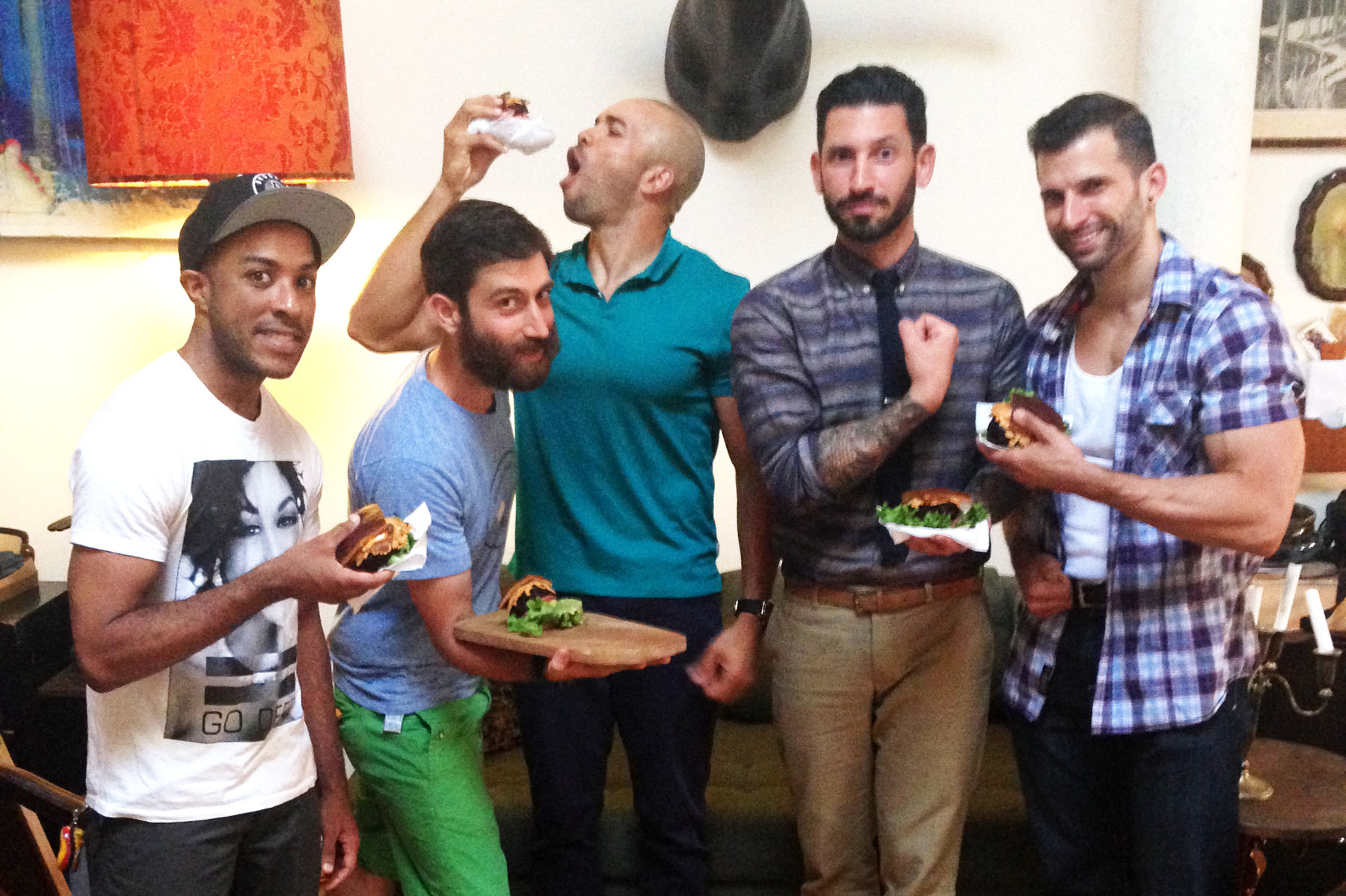 Mixed martial arts fighter Cornell Ward (from left), chef Daniel Strong, triathlete Dominic Thompson, lifestyle blogger Joshua Katcher and competitive bodybuilder Giacomo Marchese at a vegan barbecue in Brooklyn, N.Y. Photo: Courtesy of James Koroni