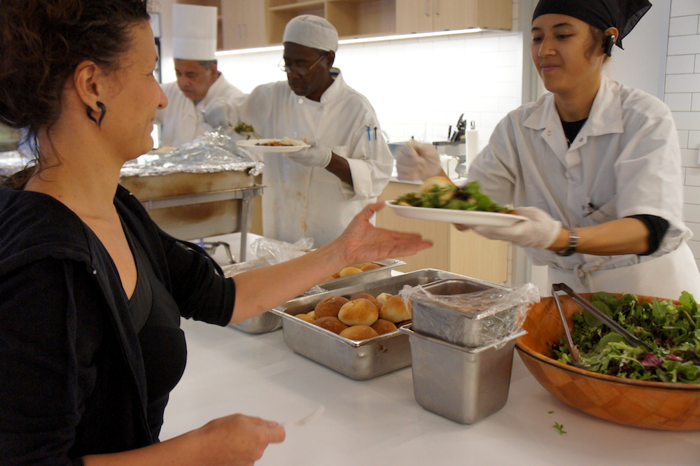 CHEFS student Safia Bubakar serves a meal to Zendesk employees. Photo: Angela Johnston