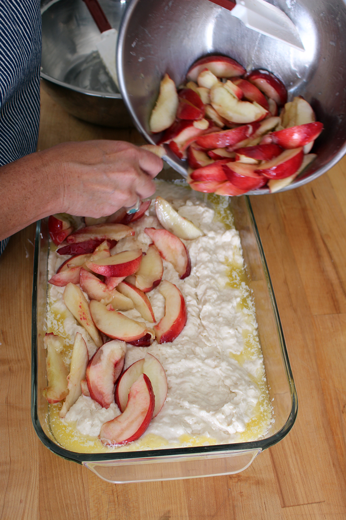 Spoon the cobbler batter into the prepared baking dish, spreading it as evenly.Top with the fruit. Photo: Wendy Goodfriend