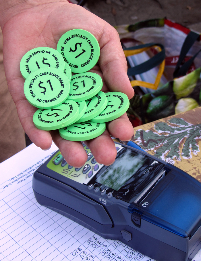 These tokens allow low-income people who receive CalFresh benefits to shop at farmers' markets. Photo: Courtesy of the Ecology Center.