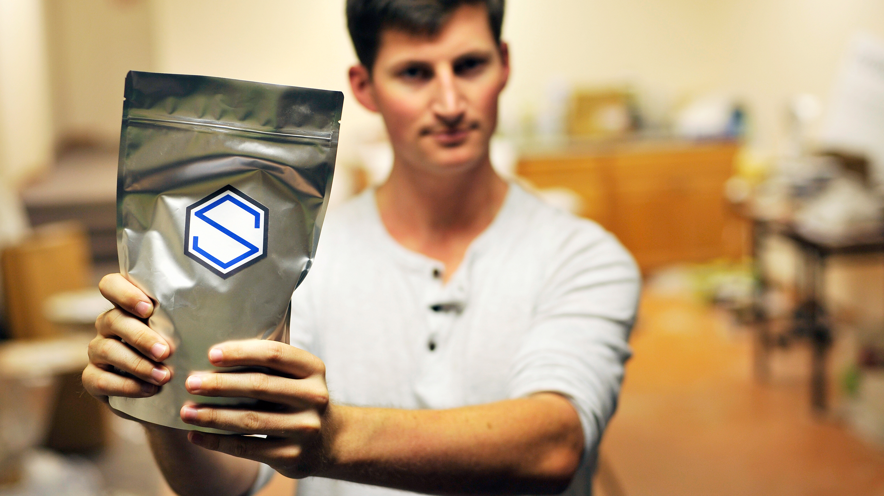 Soylent CEO Rob Rhinehart holds a bag of finished product in September 2013. Rhinehart recently discouraged members of the company's DIY online community from competing directly with Soylent. Photo: Josh Edelson/AFP/Getty Images