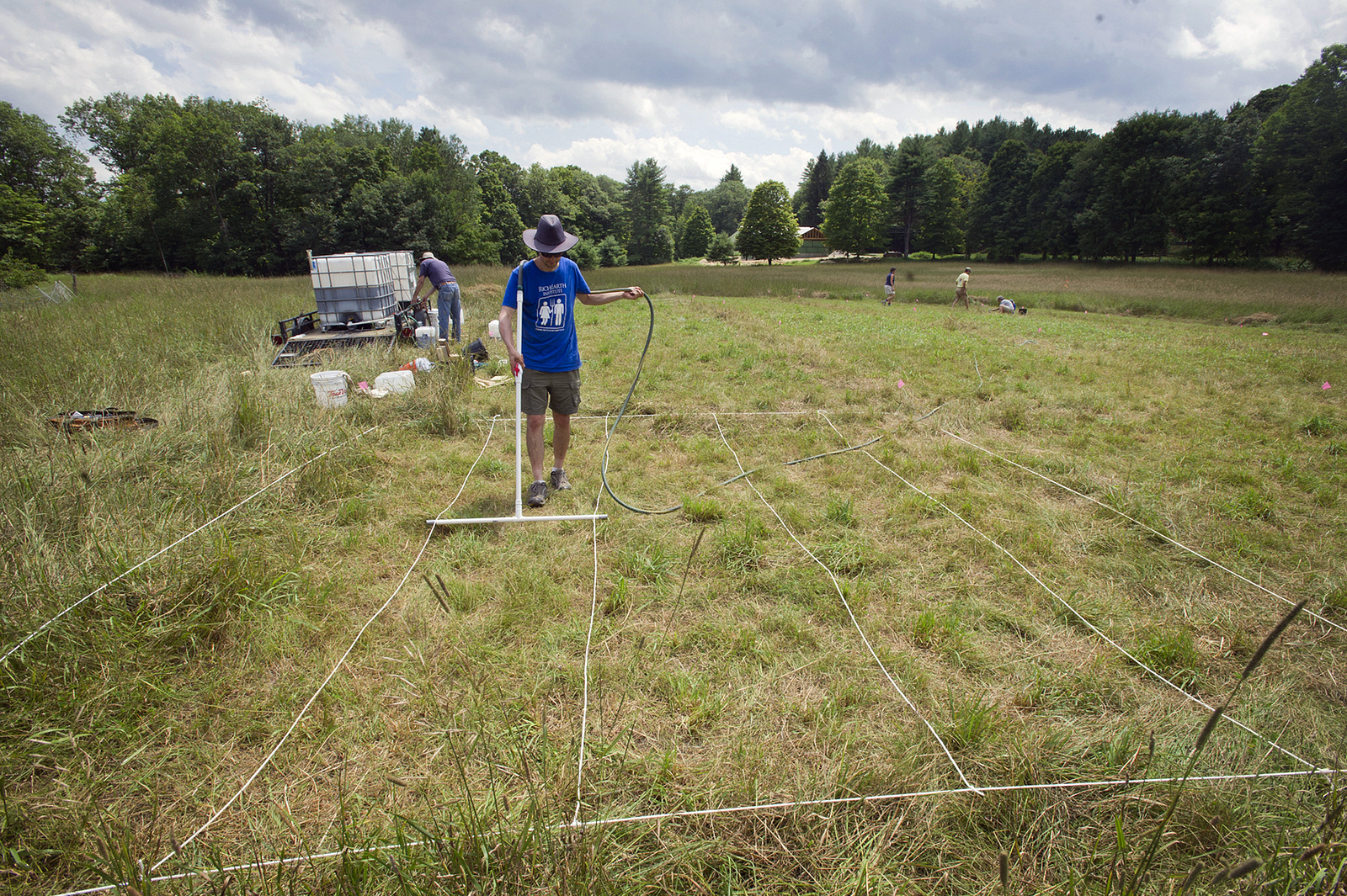Abraham Noe-Hays, research director of the Rich Earth Institute in Vermont, applies urine to a five by five-meter test plot on a hay farm. Photo: Betty Jenewin/Courtesy of Rich Earth Institute