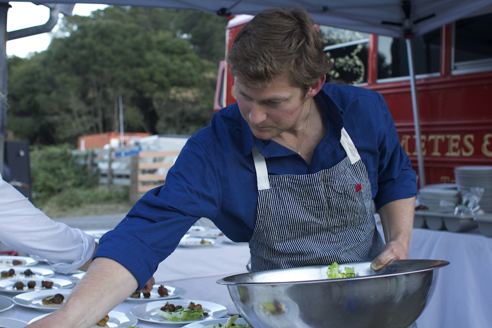 Heath Thomson prepares the second course of the night for Metes and Bounds. Photo: Angela Johnston