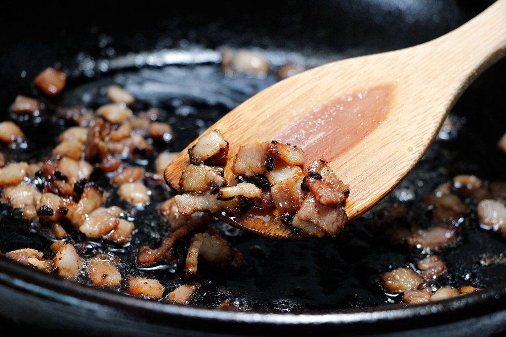 Cook the chopped bacon in a frying pan until crisp. Photo: Wendy Goodfriend