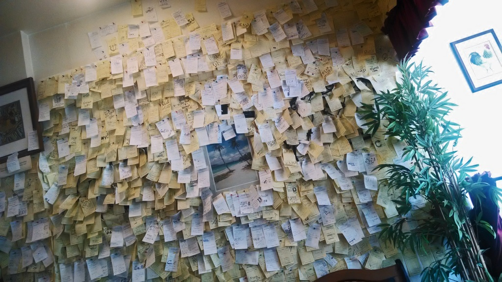 A entire wall of love and memories greets you when you enter The Brick Pig's House. Photo: Anna Vignet.