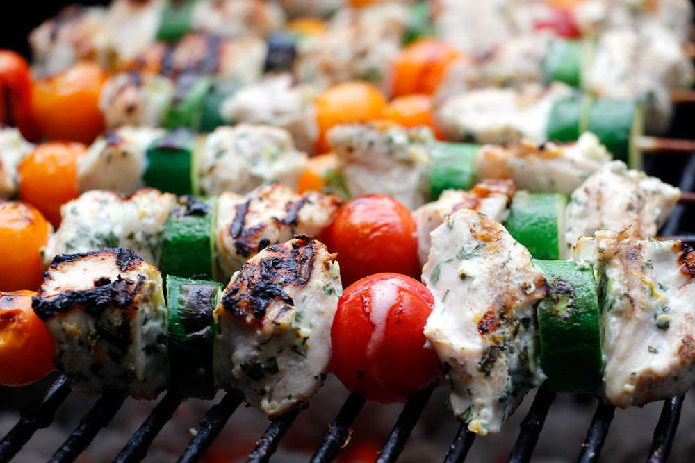 Yogurt and Herb-Marinated Chicken Kebabs with Cherry Tomatoes and Zucchini. Photo: Wendy Goodfriend