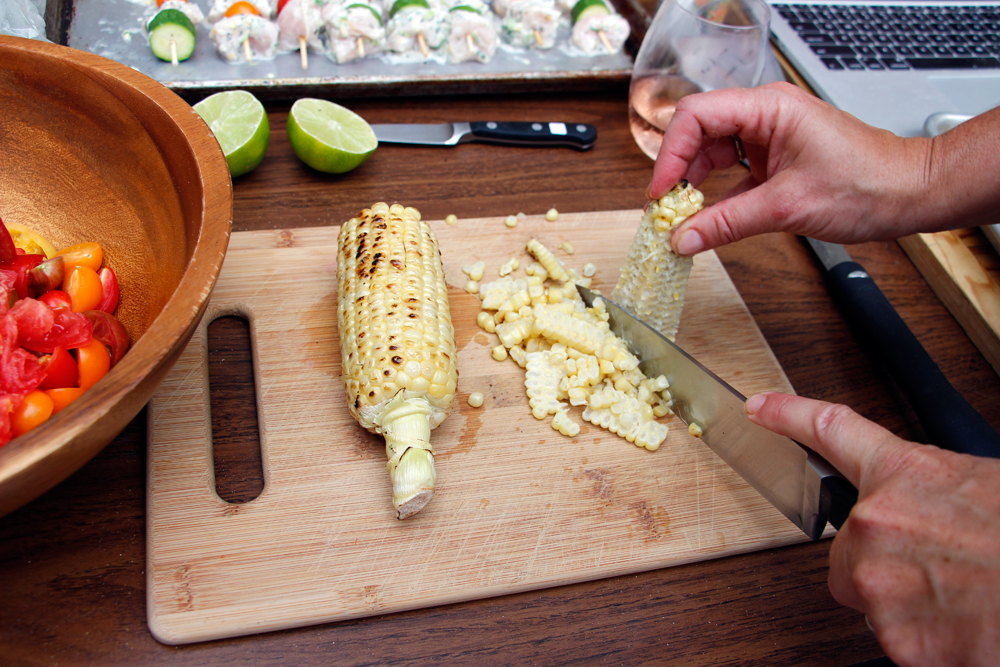 When the corn is cool enough to handle, slice the kernels from the cob and place the kernels into a large serving bowl. Photo: Wendy Goodfriend