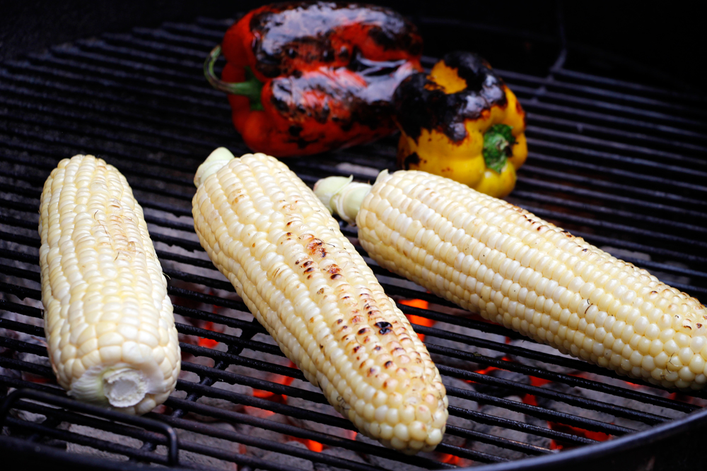 Grill the corn and peppers, turning them frequently until the peppers are blackened all over and the corn is crisp-tender and covered nicely in grill marks. Photo: Wendy Goodfriend