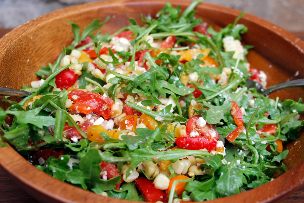 Grilled Corn, Sweet Peppers, Heirloom and Cherry Tomato, Feta, Arugula Salad. Photo: Wendy Goodfriend