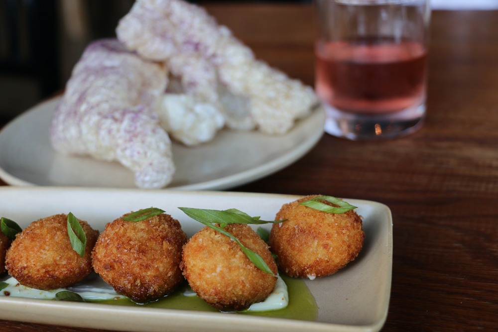 Potato croquettes with Manchego cheese and Serrano ham and chicharrones. Photo: Kim Westerman